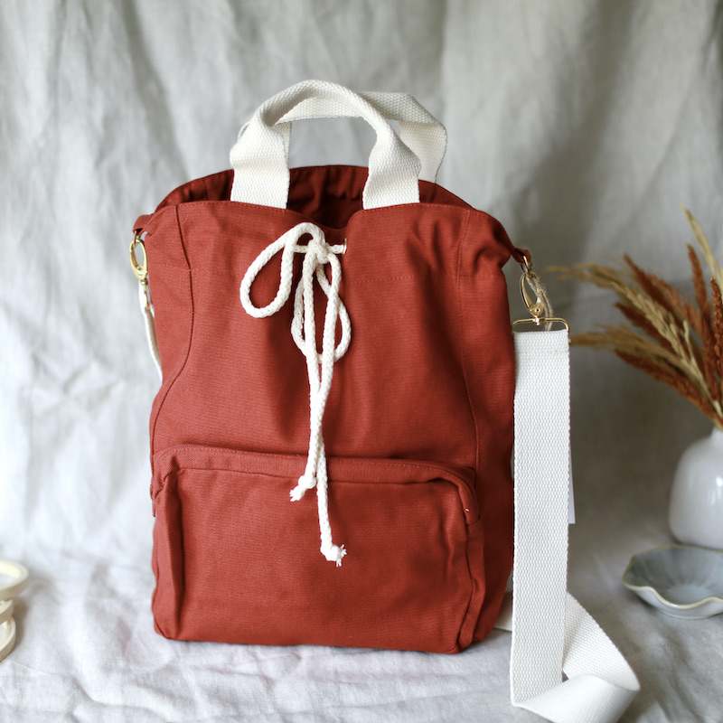 project bag plystre in rust red